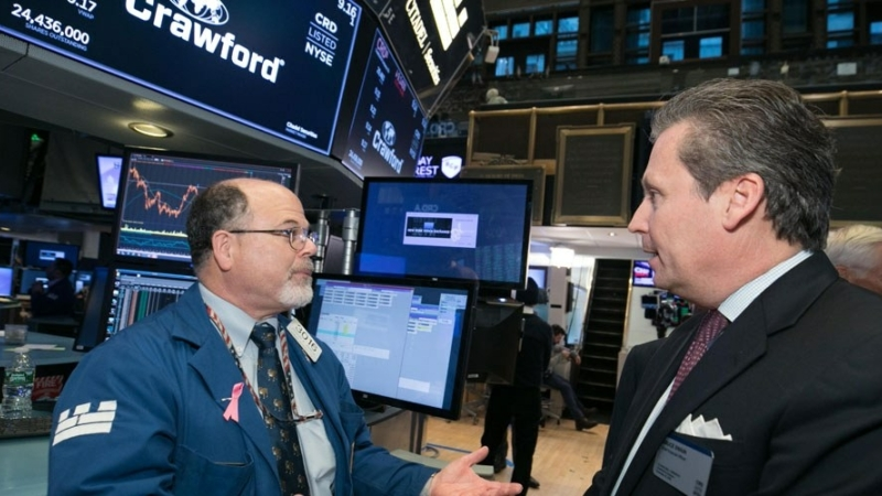 Crawford CFO, Bruce Swain, visits the floor of the New York Stock Exchange.