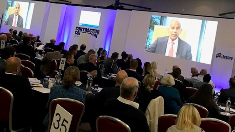 Delegates watching a video presentation from CEO and President, Harsha V Agadi, on the importance of our network partners to Crawford.